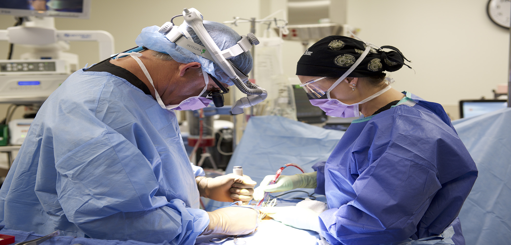 Dr Courtney preformng spine surgery at Eminent Medical Center